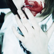 Woman with bloodstained face — Stock Photo