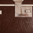 Royalty-Free Stock Photo: Lock of an old brown leather suitcase