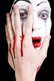 Mime with blood on face and hand — Stock Photo