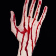 Stock Photo: Bloody humhand on black background