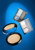 Cosmetics on blue background — Stock Photo