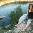Girl with laptop on Outdoors — Stock Photo #1593107