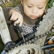 Village boy repaired a bicycle. — Stock Photo