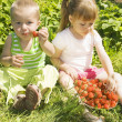 Child eating strawberries. — Stock Photo #1596181