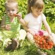 Child eating strawberries. — Stock Photo