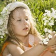 Little Girl holding flowers. - Stock Photo