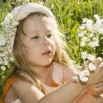 Little Girl holding flowers. — Stock Photo