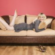 Young Woman on a sofa — Stock Photo #1597105