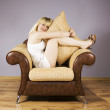 Young Woman on a armchair — Stock Photo #1597217