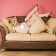 Young Woman on a sofa — Stock Photo #1597247
