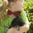 Girl with puppy — Stock Photo #1598216