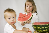Two children eat Watermelon — Stock Photo