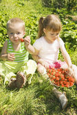 Child eating strawberries. — Stock Photo