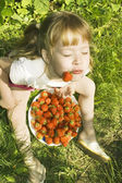Girl eating strawberries. — Stock Photo