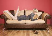 Young Woman on a sofa — Stock Photo