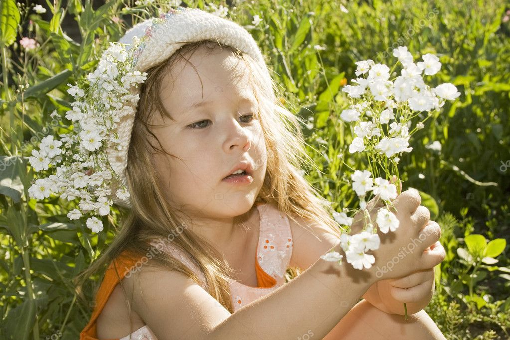 Cute Little Girl Holding Bouquet Of Flowers Stock Photo