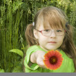 Little Girl with red flower — Stock Photo #1604863