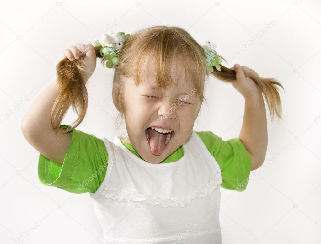 Head and hands shot of Little girl sticking out her tongue at the camera for fun — Stock Photo #1606929