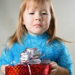 Stock Photo: Girl with unpleasant gift