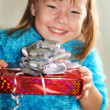 Happy girl holding a gift box — Stock Photo