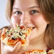 Royalty-Free Stock Photo: Girl eating Pizza