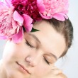 Face of woman with flower — Stock Photo