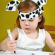 Small girl with dalmatian mask — Stock Photo