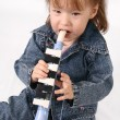 Stock Photo: Girl plays on the pipe