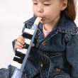 Girl plays on the pipe — Stock Photo #1700133