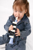 Girl plays on the pipe — Stock Photo