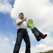 Father and his flying son — Stock Photo #2139794