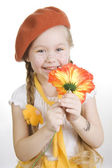 Little girl holding a flower and smile — Stock Photo