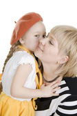 Daughter kissing her mother. — Stock Photo