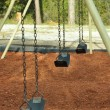 Empty swing set - Stock Photo
