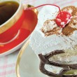 Stockfoto: Cup of tewith cake