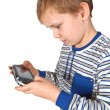 Stockfoto: Boy playing psp