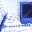 PDA and pen on stock chart — Stock Photo