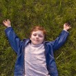 Boy on the grass — Stockfoto