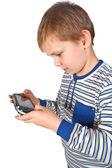 мальчик играет psp — Стоковое фото