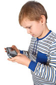 Boy playing psp — Stockfoto