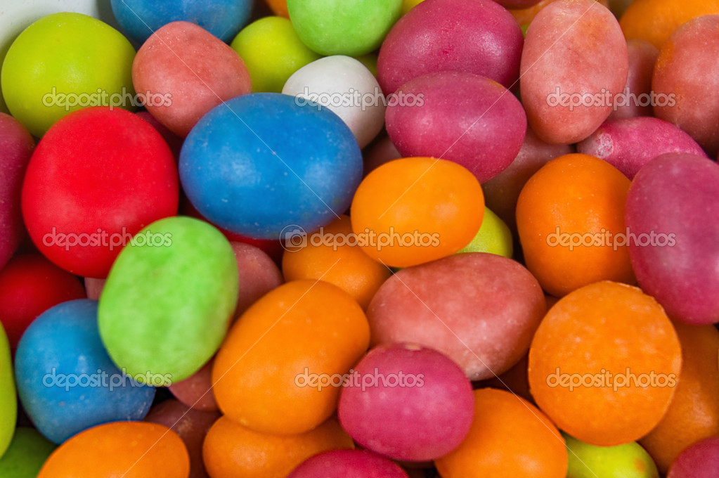 A full background of brightly colored candies — Stock Photo #1592714