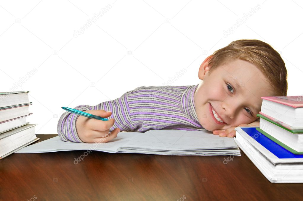 Smiling boy doing homework, isolated on white background — Stock Photo #1592780