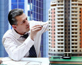 Architect with a breadboard model of a building — Stockfoto