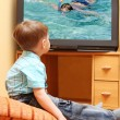 Little boy watching TV — Stock Photo