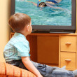 Little boy watching TV - Stock Photo