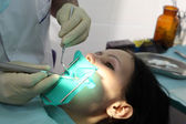 The dentist treats a teeth special tools — Stock Photo