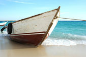Fishing boat on Egypt beach waiting for — Stock Photo