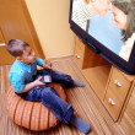 Little boy watching cinema on TV — Stock Photo