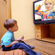Little boy watching cinema on TV — Stock fotografie