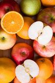 Apples and orange — Stock Photo